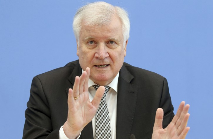 German Interior minister Horst Seehofer gestures as he attends a news conference in Berlin, Germany, Tuesday, May 14, 2019.  German security officials say the number of anti-Semitic and anti-foreigner incidents rose in the country last year, despite an overall fall in politically motivated crimes. (Wolfgang Kumm/dpa via AP)