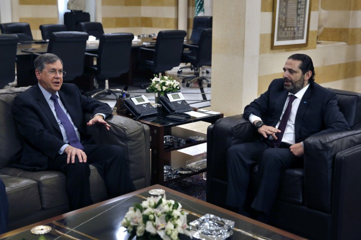 U.S. Deputy Assistant Secretary of State David Satterfield, left, speaks during his meeting with Lebanese Prime Minister Saad Hariri, in Beirut, Lebanon, Tuesday, May 14, 2019. (AP Photo/Bilal Hussein)
