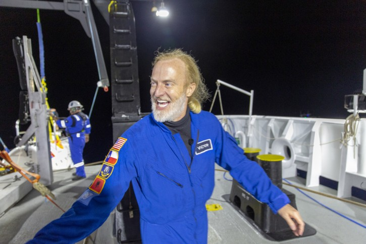 In this photo provided by Atlantic Productions for Discovery Channel, Victor Vescovo emerges from his submersible 'Limiting Factor' after a successful dive to the deepest known point in the Mariana Trench, April 28, 2019. Vescovo, a businessman and amateur pilot, has also traversed the highest peaks of mountains, including Mount Everest. (Tamara Stubbs/Atlantic Productions for Discovery Channel via AP)