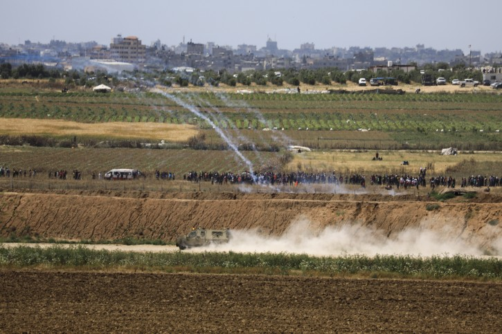 Israeli troops fire tear gas at Palestinian protestord at he Israel and Gaza border fence, Wednesday, May 15, 2019.  (AP Photo/Tsafrir Abayov)