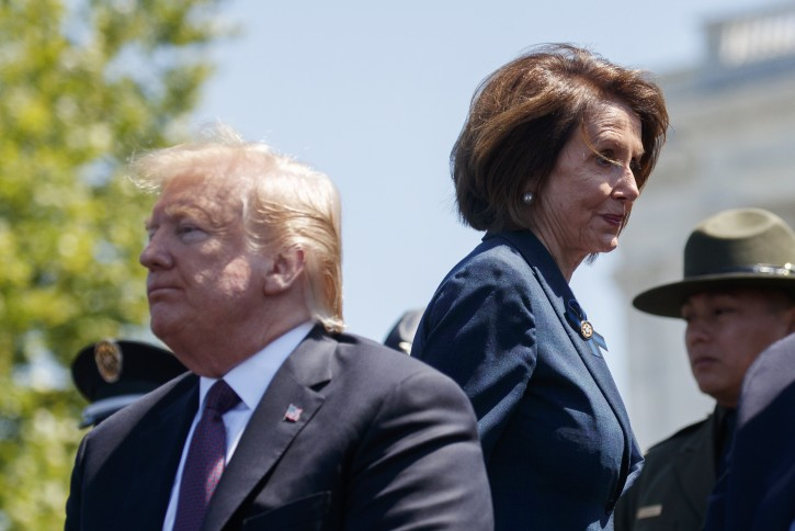 Speaker of the House Nancy Pelosi of Calif., walks past Attorney General William Barr and  President Donald Trump during the 38th Annual National Peace Officers' Memorial Service at the U.S. Capitol, Wednesday, May 15, 2019, in Washington. (AP Photo/Evan Vucci)
