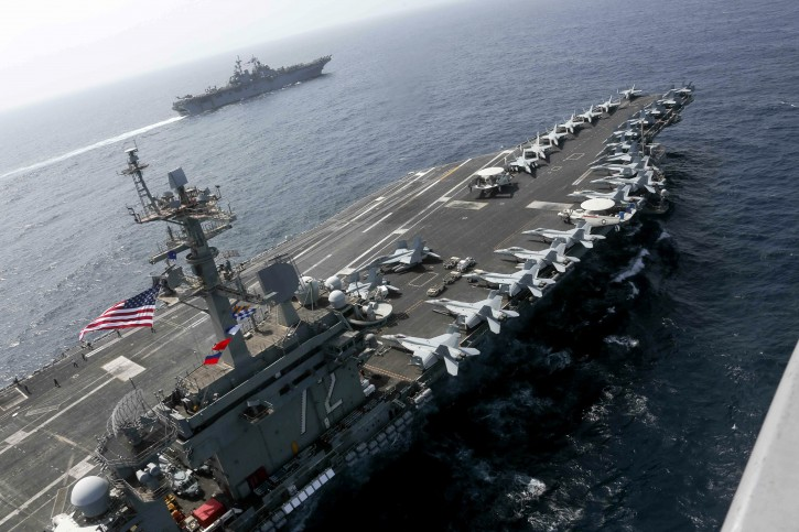 In this Friday, May 17, 2019 photo released by the U.S. Navy, the USS Abraham Lincoln is seen sailing in the Arabian Sea near the amphibious assault ship USS Kearsarge. AP