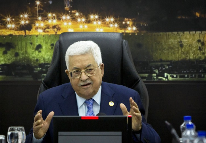 Palestinian President Mahmoud Abbas, center, chairs a session of the weekly cabinet meeting, in the West Bank city of Ramallah, Monday, April 29, 2019.(AP Photo/Majdi Mohammed, Pool)