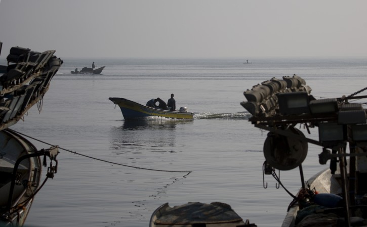 Palestinian fishermen unload their catch from boats after a night fishing trip, in the Gaza Seaport, Tuesday, May. 21, 2019. Israel extended the permitted fishing zone along the Mediterranean coast on Tuesday to a maximum of 15 nautical miles up from the previous limit of six nautical miles. (AP Photo/Hatem Moussa)