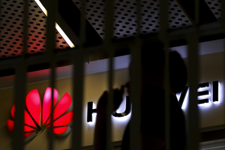 A man walks by a Huawei retail shop behind a handrail inside a commercial office building in Beijing, Tuesday, May 21, 2019.(AP Photo/Andy Wong)