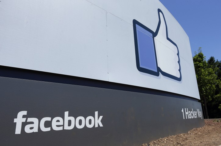 FILE - This July 16, 2013 file photo shows a sign at Facebook headquarters in Menlo Park, Calif. Facebook has more than doubled its New Mexico footprint with the purchase of more than 400 acres near its new data center. (AP Photo/Ben Margot, File)