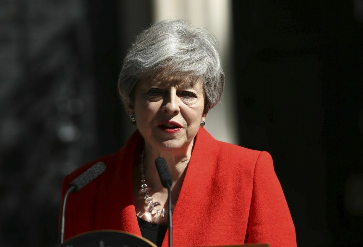 Britain's Prime Minister Theresa May makes a statement outside at 10 Downing Street in London, Friday May 24, 2019. Theresa May says she'll quit as UK Conservative leader on June 7, sparking contest for Britain's next prime minister. (Yui Mok/PA via AP)