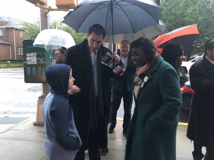Farah Louis (R) at a polling station today