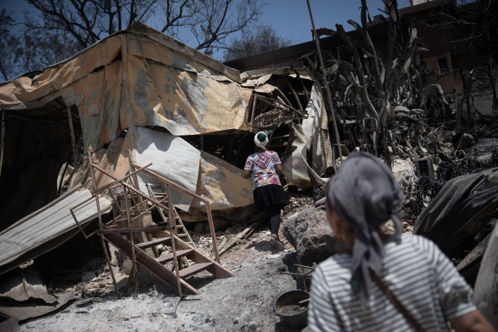 Residents check what is left of their homes after a forest fire wiped out most of the houses last week in Mevo Modi'im, near Ben Shemen Forest, on May 26, 2019. Photo by Hadas Parush/Flash90