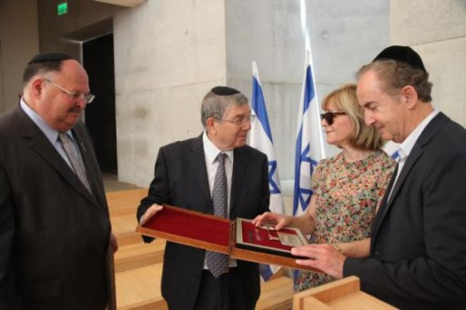 FILE - on the Right Honored donors Heather Reisman and Gerald Schwartz receive the Yad Vashem Key from Avner Shalev on June 18, 2015