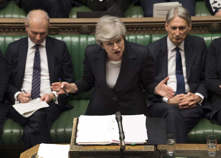 A handout photo made available by the UK Parliament shows British Prime Minister Theresa May (C) addressing members of Parliament during Prime Minister's Questions (PMQs) at the House of Commons in central London, Britain, 22 May 2019. EPA