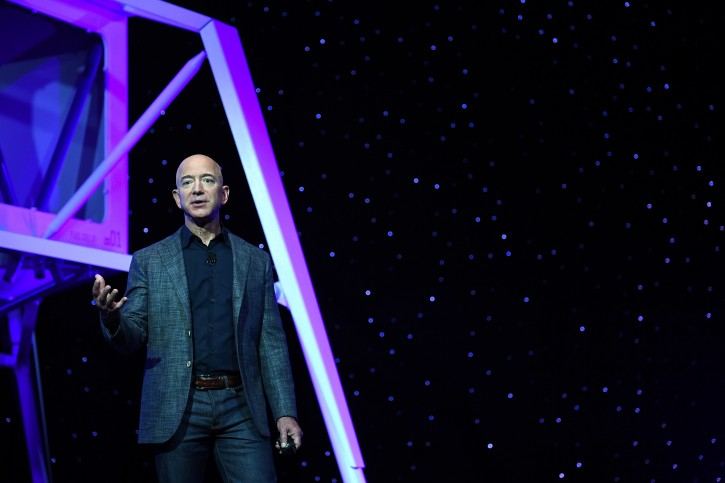 FILE - Founder, Chairman, CEO and President of Amazon Jeff Bezos unveils his space company Blue Origin's space exploration lunar lander rocket called Blue Moon during an unveiling event in Washington, U.S., May 9, 2019. REUTERS/Clodagh Kilcoyne