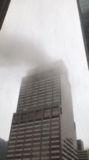 Smoke is seen rising from a building after a helicopter crash in New York City, New York, U.S., June 10, 2019 in this still image taken from a video obtained from social media. LANCE KOONCE/via REUTERS