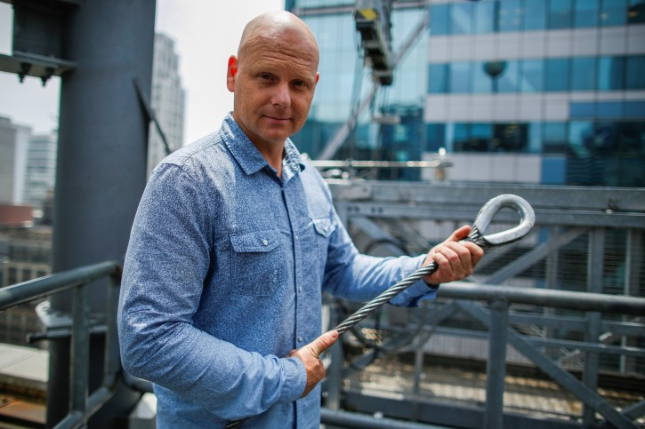 Aerialist Nik Wallenda holds a sample of a wire while he speaks with media as he prepares for a highwire walk over Times Square in New York, U.S., June 20, 2019.  REUTERS/Eduardo Munoz