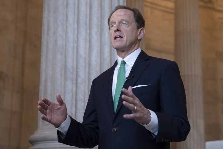Sen. Pat Toomey, R-Pa., discusses President Donald Trump's revamped North American trade agreement with Canada and Mexico during a television news interview on Capitol Hill in Washington, Tuesday, Oct. 2, 2018. (AP Photo/J. Scott Applewhite)