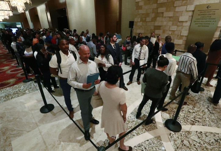 In this Tuesday, June 4, 2019 photo, job applicants line up at the Seminole Hard Rock Hotel & Casino Hollywood during a job fair in Hollywood, Fla. (AP Photo/Wilfredo Lee)