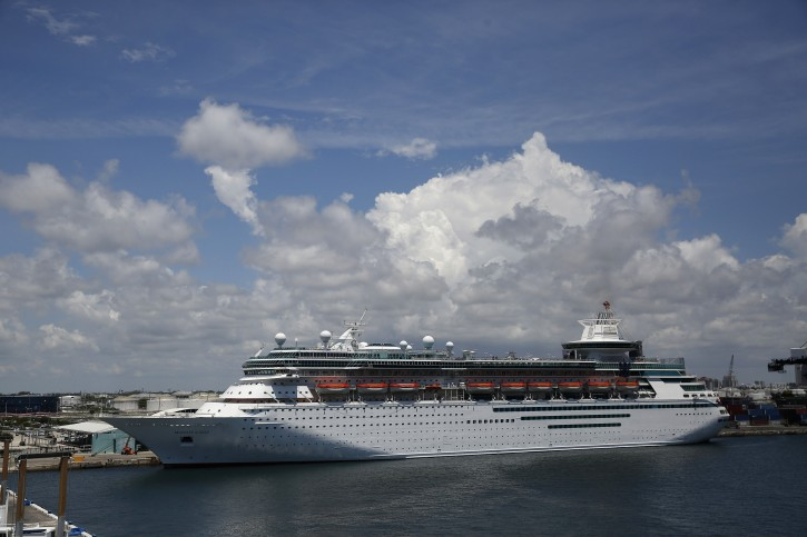 A Royal Caribbean Cruise ship called the Majesty of the Seas sets out at Port Everglades and will no longer go to Cuba, on Wednesday, June 5, 2019, in Fort Lauderdale, Fla.  (AP Photo/Brynn Anderson)