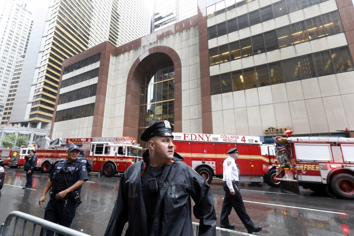 New York City Police and Fire Department personnel secure the scene in front of a building in midtown Manhattan where a helicopter crash landed, Monday, June 10, 2019. AP