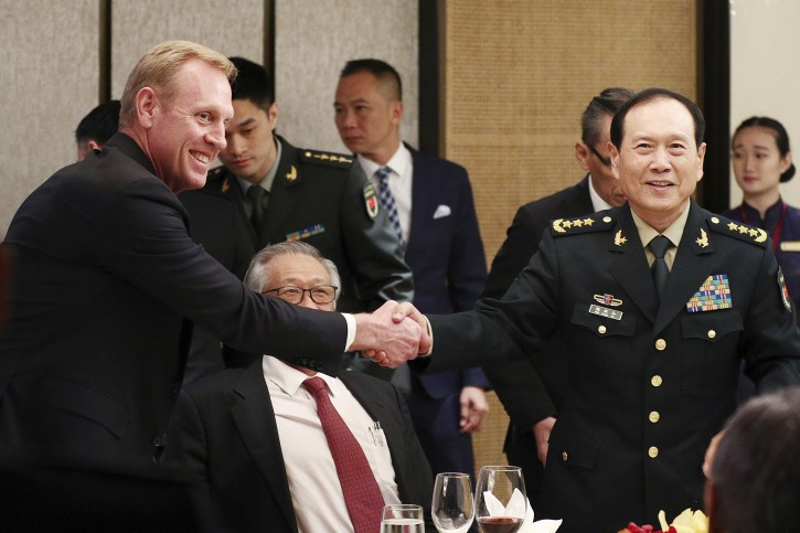 FILE - In this June 1, 2019, file photo, acting U.S. Secretary of Defense Patrick Shanahan, left, shakes hands with Chinese Minister of National Defense Gen. Wei Fenghe, right, during a ministerial luncheon on the sidelines of the 18th International Institute for Strategic Studies (IISS) Shangri-la Dialogue in Singapore. (AP Photo/Yong Teck Lim, File)