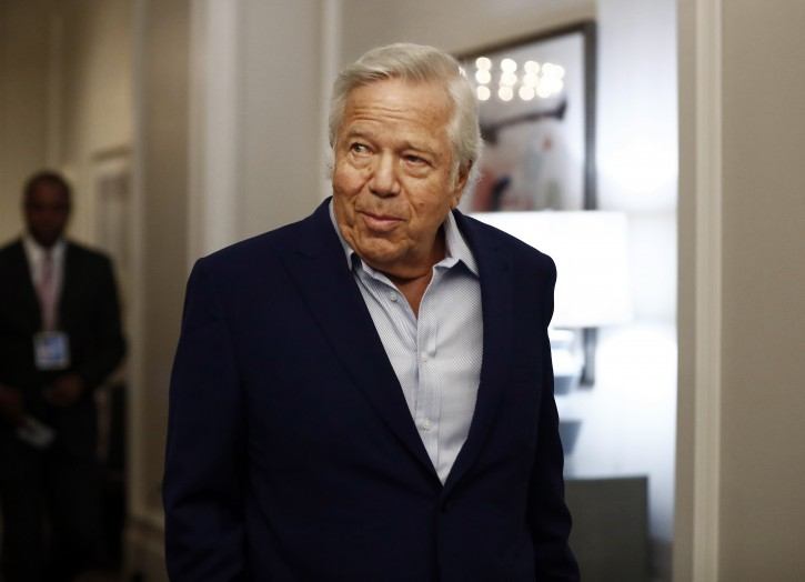 FILE - In this Wednesday, May 22, 2019 file photo, New England Patriots owner Robert Kraft arrives to the NFL football owners meeting in Key Biscayne, Fla.(AP Photo/Brynn Anderson, File)