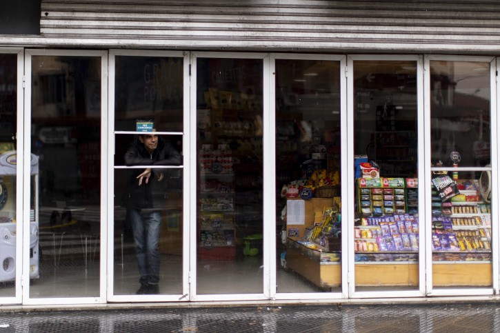 A man stands inside a store without power during the blackout, in Buenos Aires, Argentina, Sunday, June. 16, 2019. A widespread power failure early Sunday morning left a large section of South America, including all of Argentina and Uruguay, without power. AP Photo/Tomas F. Cuesta)