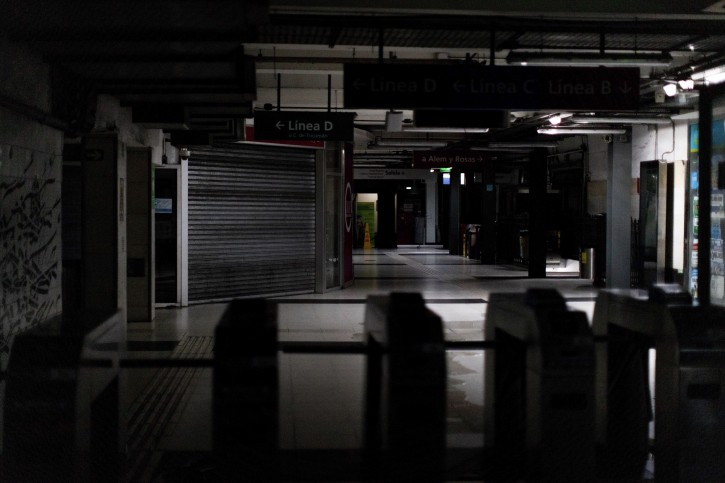 Hallways of Buenos Aires's Subway lit only by emergency lights during the blackout, in Buenos Aires, Argentina, Sunday, June. 16, 2019. A widespread power failure early Sunday morning left a large section of South America, including all of Argentina and Uruguay, without power. AP Photo/Tomas F. Cuesta)