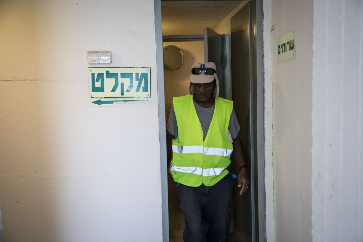 FILE - People check the public bomb shelter on a street in the southern Israeli city of Ashkelon, on November 13, 2018. Photo by Hadas Parush/Flash90
