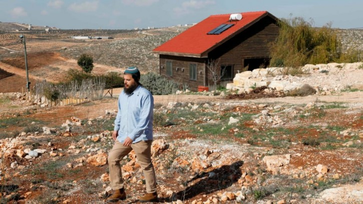 FILE - Nati Rom, the founder of Israel's Lev Haolam organization, walks next to an Airbnb apartment located in the Esh Kodesh outpost near the Jewish settlement of Shilo in the West Bank on November 20, 2018. EPA