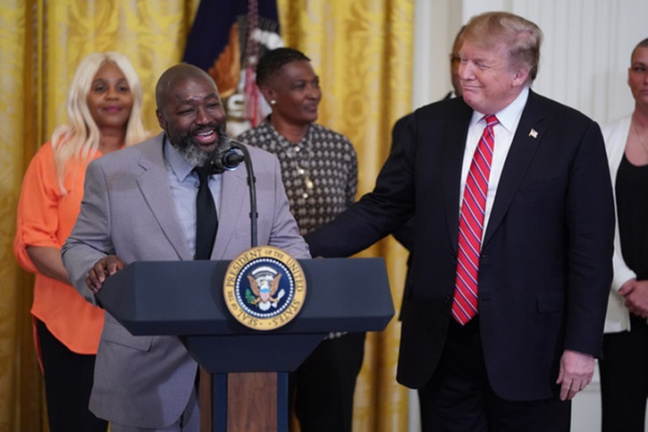 "Matthew Charles, who was released from from federal prison after serving 20 years for selling crack cocaine, joins U.S. President Donald Trump for a First Step Act celebration in the East Room of the White House April 01, 2019 in Washington, DC. The First Step Act passed Congress with bipartisan support in December 2018, prompting the release of more than 500 inmates as a result. Trump praised the reform legislation as proof that the United States ""believes in redemption."" Reuters"