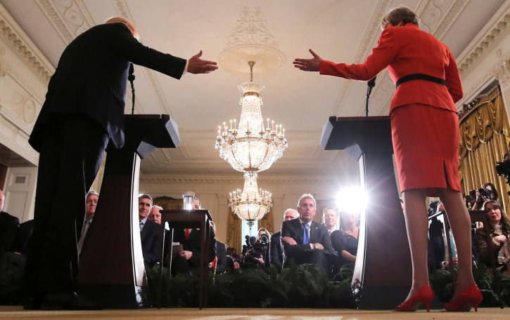 Britain's ambassador to the United States Kim Darroch (C) listens as U.S. President Donald Trump and British Prime Minister Theresa May hold a joint news conference at the White House in Washington, U.S., January 27, 2017.  REUTERS/Carlos Barria