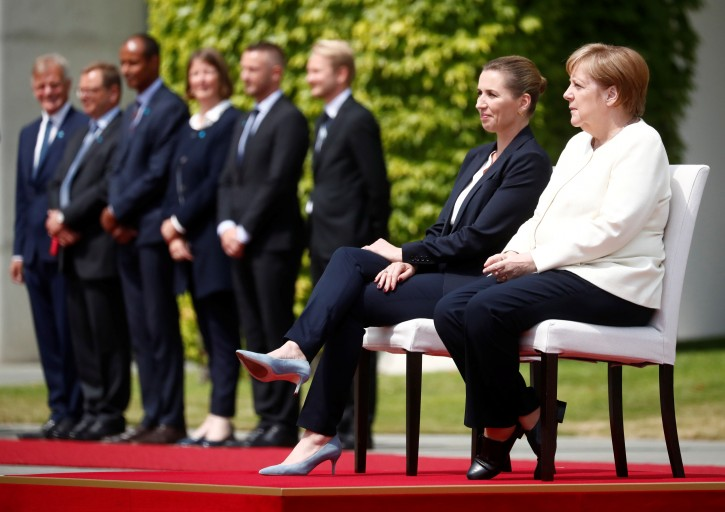 German Chancellor Angela Merkel receives Denmark's Prime Minister Mette Frederiksen with military honours at the Chancellery in Berlin, Germany, July 11, 2019. REUTERS/Hannibal Hanschke