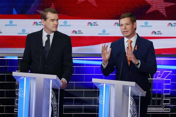 Democratic presidential candidate Rep. Eric Swalwell, D-Calif., right, speaks during the Democratic primary debate hosted by NBC News at the Adrienne Arsht Center for the Performing Arts, Thursday, June 27, 2019, in Miami. To the left is former Colorado Sen. Michael Bennet. (AP Photo/Wilfredo Lee)