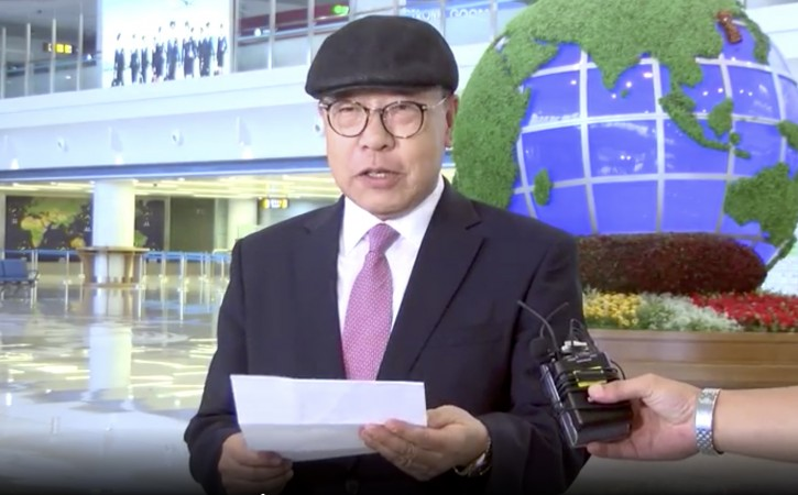 In this image made from video taken on Saturday, July 6, 2019, by North Korean Uriminzokkiri state-run website, shows the son of the highest-profile South Korean ever to defect to North Korea, Choe In-guk giving a statement to media as he arrived in the North to permanently resettle. (Uriminzokkiri via AP)