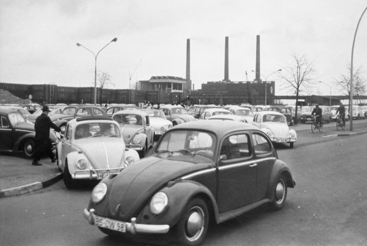 FILE - In this April 27, 1966 file photo, Volkswagen workers drive their Beetle cars from the parking lot on their way home at the end of a days work at the world's largest single auto plant, the Volkswagen factory (seen in background) in Wolfsburg, Germany. (AP Photo, file)