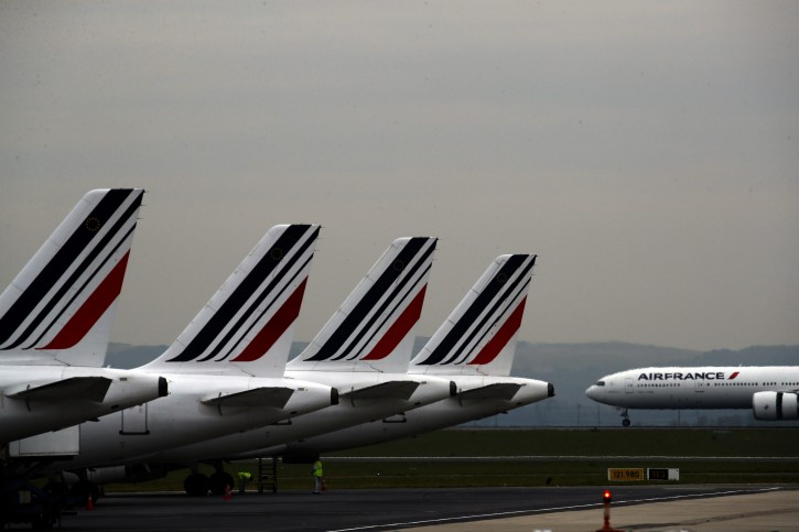 """FILE - In this May 17, 2019 file photo, Air France planes are parked on the tarmac at Paris Charles de Gaulle airport, in Roissy, near Paris. The French government will implement an """"ecotax"""" on plane tickets for flights departing from France from next year, the government said Tuesday July 9, 2019. The tax is expected to raise over 180 million euros ($200 million) from 2020 to invest in eco-friendly transport infrastructure, including rail. (AP Photo/Christophe Ena, File)"""