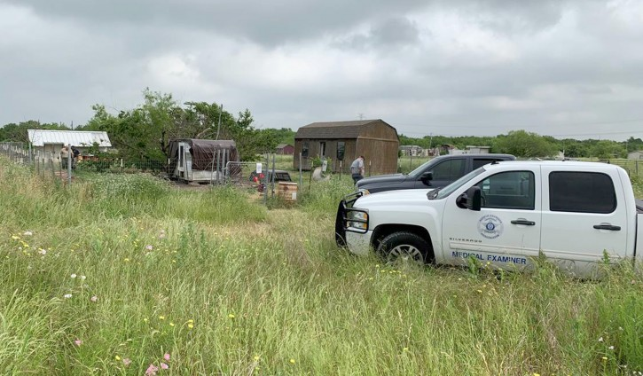 This May 20, 2019 photo provided by the Johnson County Sheriff's Office shows a medical examiners truck on the property of Freddie Mack's home in Venus, Texas AP