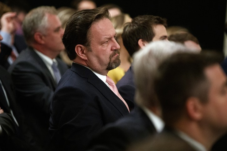 """Radio host Seb Gorka listens as President Donald Trump speaks during the """"Presidential Social Media Summit"""" in the East Room of the White House, Thursday, July 11, 2019, in Washington. (AP Photo/Evan Vucci)"""