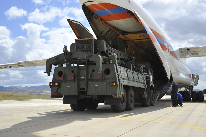 Military vehicles and equipment, parts of the S-400 air defense systems, are unloaded from a Russian transport aircraft, at Murted military airport in Ankara, Turkey, Friday, July 12, 2019. T(Turkish Defence Ministry via AP, Pool)