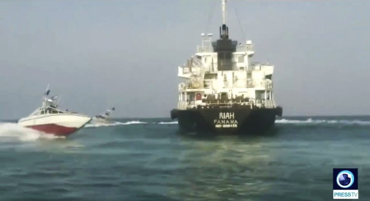 This undated photo provided by Iranian state television's English-language service, Press TV, shows the Panamanian-flagged oil tanker MT Riah surrounded by Iranian Revolutionary Guard vessels. AP