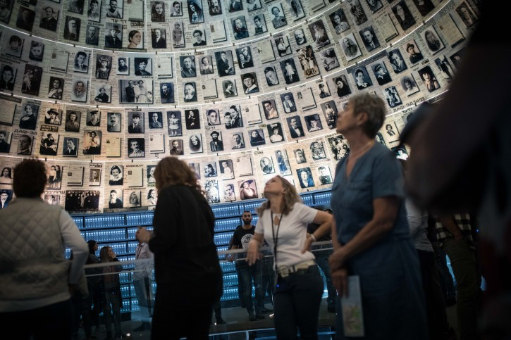 FILE - Visitors seen at the Yad Vashem Holocaust Memorial museum in Jerusalem on April 28, 2019, ahead of Israeli National Holocaust Remembrance Day. Photo by Hadas Parush/Flash90