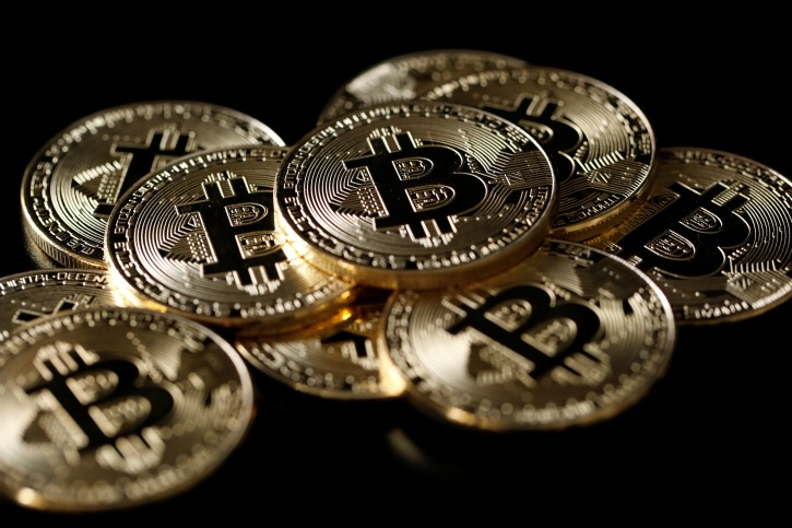 A collection of Bitcoin (virtual currency) tokens are displayed in this picture illustration taken December 8, 2017. REUTERS