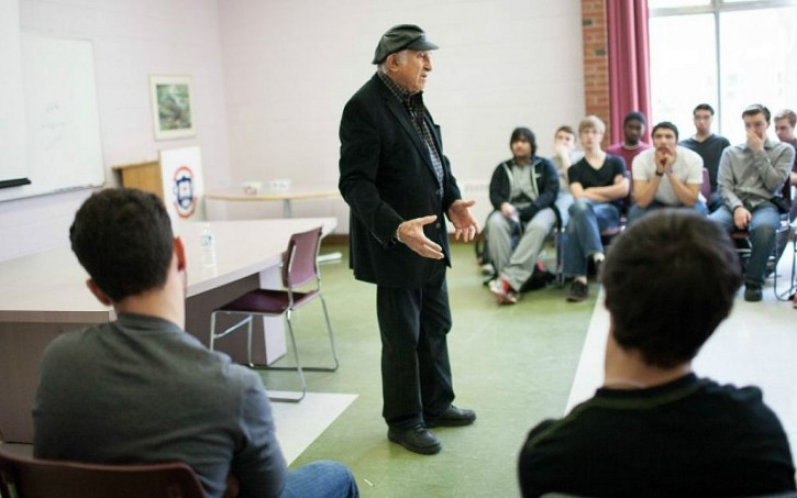 FILE - Holocaust survivor Nate Leipciger speaking to a class of students participating in the Facing History and Ourselves curriculum. (Courtesy of Facing History and Ourselves/JTA)