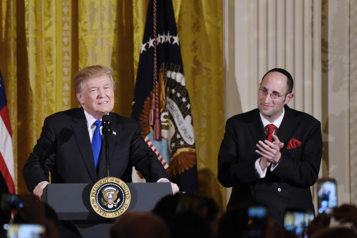 FILE -  US President Donald J. Trump speaks as rabbi Meir Yaakov Soloveichik looks on during a Hanukkah Reception in the East Room of the White House Washington, DC, USA, 07 December 2017.  EPA-EFE/OLIVIER DOULIERY / POOL
