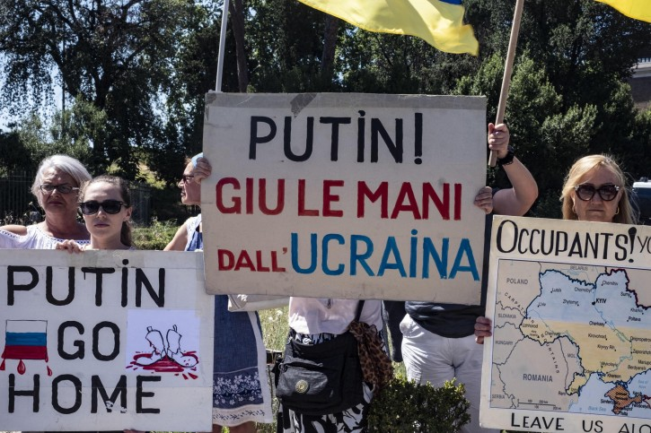 Ukrainian people hold a banner reading 'Putin, hands off Ukraine!' as they attend a demonstration against Russian President Vladimir Putin in Rome, Italy, 04 July 2019. EPA