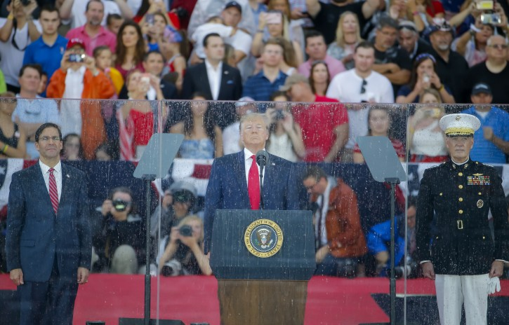 US President Donald J. Trump (C, flanked by acting Secretary of Defense Mark Esper (L) and Chairman of the Joint Chiefs of Staff General Joseph Dunford (R), speaks during US Independence Day celebrations at the Lincoln Memorial in Washington, DC, USA, 04 July 2019.  EPA