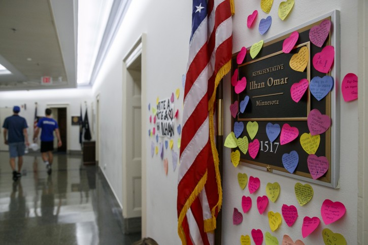 Heart shaped Post-its line the wall outside the office of Rep. Ilhan Omar, D-Minn., Friday, July 19, 2019, part of a day-long solidarity vigil organized by anti-war protest group Code Pink, on Capitol Hill in Washington. (AP Photo/Jacquelyn Martin)