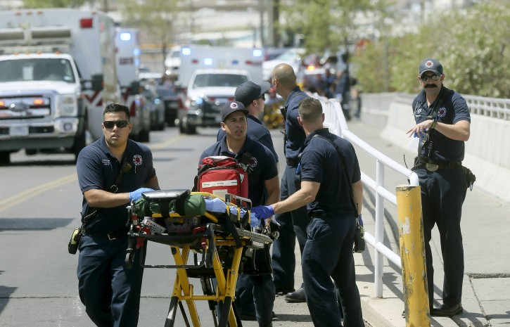 FILE - In this Aug. 3, 2019 file photo, El Paso Fire Medical personnel arrive at the scene of a shooting at a Walmart near the Cielo Vista Mall in El Paso, Texas. AP