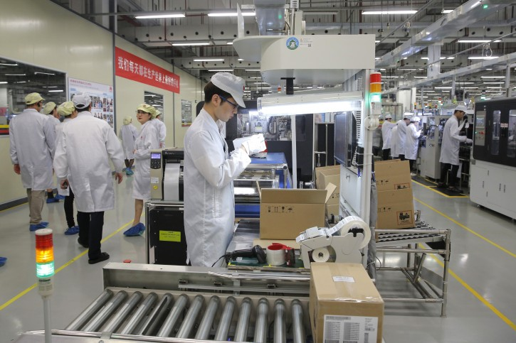 A staff member works at a mobile phone production line during a media tour in Huawei factory in Dongguan, China's Guangdong province, Wednesday, March 6, 2019. Huawei Technologies Co. is one of the world's biggest supplier of telecommunications equipment. (AP Photo/Kin Cheung)