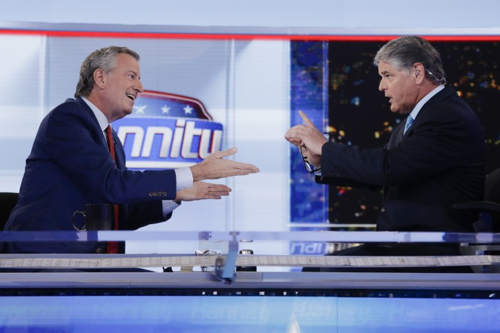 Fox News talk show host Sean Hannity, right, interviews Democratic presidential candidate and New York Mayor Bill de Blasio during a taping of his show Wednesday, Aug. 7, 2019, in New York.  (AP Photo/Frank Franklin II)