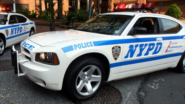 NYPD vehicles are pictured in New York on Monday, Aug. 14, 2006. (AP / Mary Altaffer)